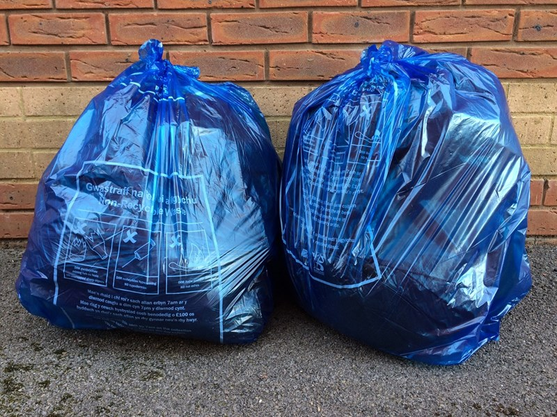 Blue Refuse Bags Full And Ready For Collection
